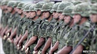 Soldiers stand guard during the 98th anniversary of the creation of the Mexican army on 19 February, 2011