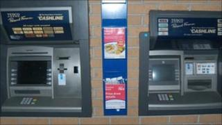 ATMs, one with card skimmer (left)
