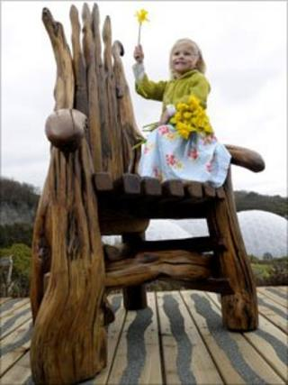Grace, three, tries out the chair at its new location