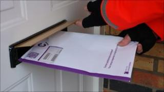 A Census form being delivered