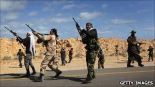 Libyan rebels firing
