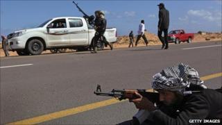 Libyan rebels take up positions near Ben Jawat, 6 March 2011