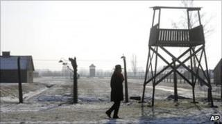 Visitor at Auschwitz death camp, Poland (1 February 2011)
