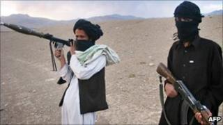 In this file photo taken on September 26, 2008, fighters with Afghanistan's Taliban militia pose on a hillside at Maydan Shahr in Wardak province, west of Kabul