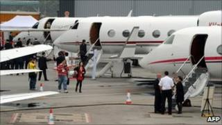 Private business jets parked on the tarmac