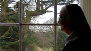 Reverend Mother Mary Luke looking out of the window