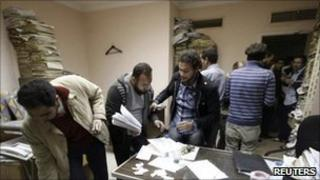 Egyptians search through secret papers