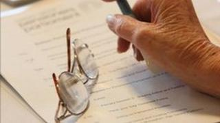 Pensioner's hand and glasses