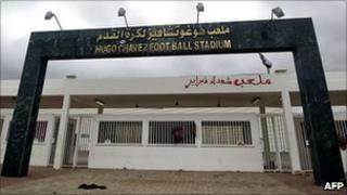 View of the main gate of the stadium named after Hugo Chavez outside Benghazi, with graffiti in Arabic reading Martyrs of February