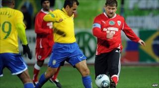 Dunga, left, plays Chechen leader Ramzan Kadyrov