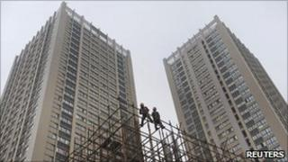 Labourers work at a residential construction site