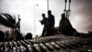Libyan rebel fighters amass ammunition near the town of Ras Lanuf, 8 March 2011
