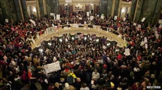 Protesters take over the Wisconsin state capitol in Madison after the vote
