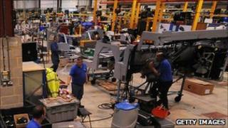 Workers at the Alexander Dennis factory in Guildford, UK