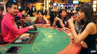 Customers at a gambling table