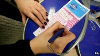 Woman filling out EuroMillions form