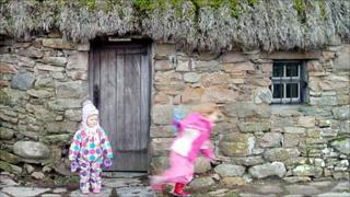 Children playing at the Leanach Cottage on Culloden battlefield