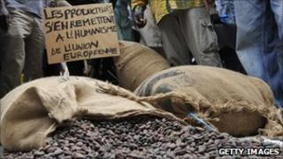 Bags of cocoa being ripped open during protest