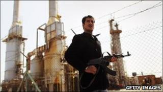 Libyan rebel outside oil refinery