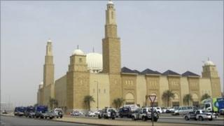Saudi policemen form a check point outside Al Rajhi mosque, where a demonstration expected to take place in Riyadh, Saudi Arabia, Friday, March 11, 2011.