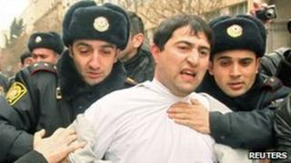 Police detain an opposition activist in Baku, 11 March