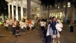 Hotel guests from the Moana Surfrider evacuate early Friday, March 11, 2011 in Honolulu