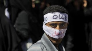 An anti-government protestor takes part in a demonstration demanding the resignation of Yemeni President Ali Abdullah Saleh, in Sanaa, Yemen, 11 March 2011