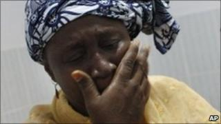 Woman cries after seeing her shot relative in Abidjan