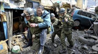 Japanese soldiers rescue man in Kesennuma, Miyagi prefecture