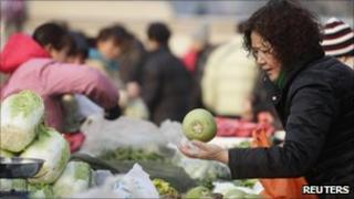 A woman buying vegetables in Beijing