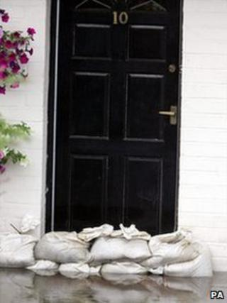 Sandbags against a front door to act as a flood defence in past flooding in Tewkesbury, Gloucestershire