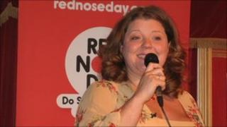 Amanda Thomson doing stand up comedy for Comic Relief