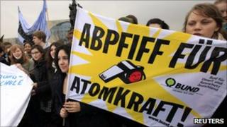 """High school students holding up a banner reading """"Final whistle for nuclear power"""" in Berlin (14 March 2011)"""