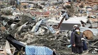 People walk through rubble in Minami-Sanrikucho
