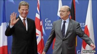 German Foreign Minister Guido Westerwelle (L) with French Foreign Minister Alain Juppe (15 March 2011)