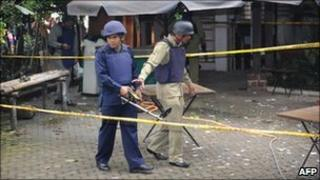 Police inspect the site where a bomb exploded at the office of a moderate Islamic group in Jakarta
