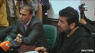 Salah Mohammed Ali Aboaoba (r) with an interpreter