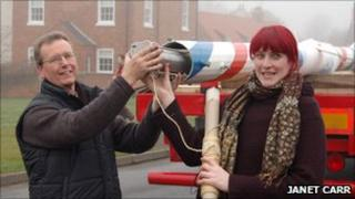 Peter Burton and Fay Stothard insert a time capsule into the maypole