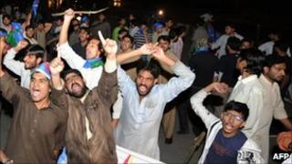 Jamaat-i-Islami supporters shout slogans as they march toward the US embassy