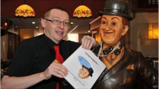 Michael Durkin with the returned Stan Laurel statue