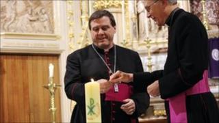 Bishop of Pontefract and Bishop of Hallam lighting a candle