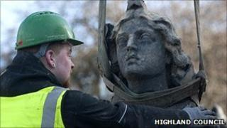 Workman with the head of Charity statue. Pic: Highland Council