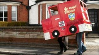 Barwell Junior School's Nick Holt and Amelia Kirkham carrying the Postman Pat van