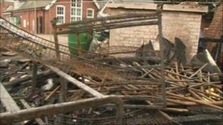 Piles of wood at the school following the fire