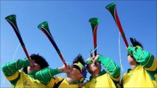 South African fans blow Vuvuzelas