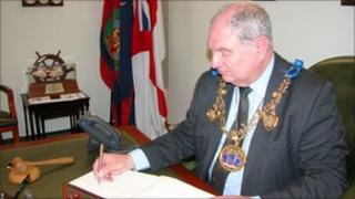 Mayor of Medway David Brake signs the book of condolence