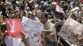 Egyptians shout slogans during a protest against the changes in Tahrir Square in Cairo, on 18 March.