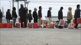 Japanese wait in line for fuel in Fukushima city, Fukushima prefecture on Sunday