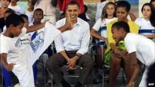 Barack Obama and wife Michelle attend a capoeira show in the City of God favela