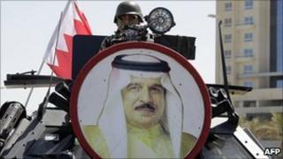 A picture of Bahraini King Hamad bin Isa al-Khalifa decorates a tank as armed forces secure Manama's Pearl Square on Saturday